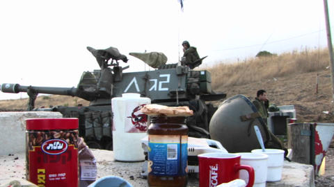 A table of rations stands next to an Israel army unit and... Stock Video Footage