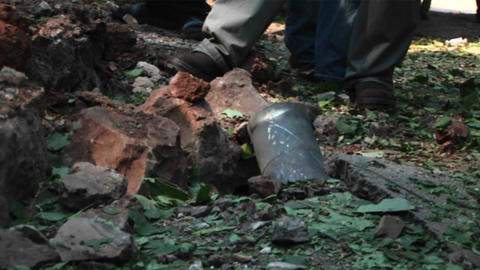Israeli civilians look at the remains of a mortar shell... Stock Video Footage