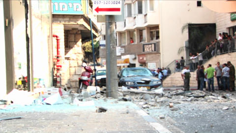 Broken glass and debris line the streets of Haifa, Israel after a rocket attack during the Israel - Footage