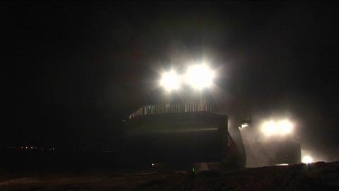 Armored Israeli bulldozers move along the Gaza Strip... Stock Video Footage