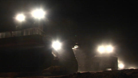 Armored Israeli bulldozers move along the Gaza Strip border in a night patrol operation Footage