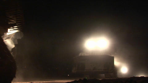 Armored Israeli bulldozers move along the Gaza Strip... Stock Video Footage