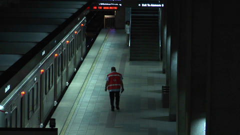 A woman enters the subway and a worker walks nearby Footage