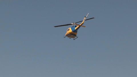 A search and rescue helicopter flies at day Stock Video Footage
