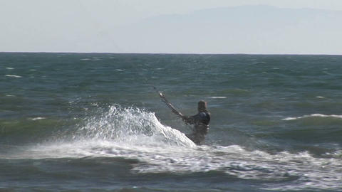 A kitesurfer catches air from a wave Footage