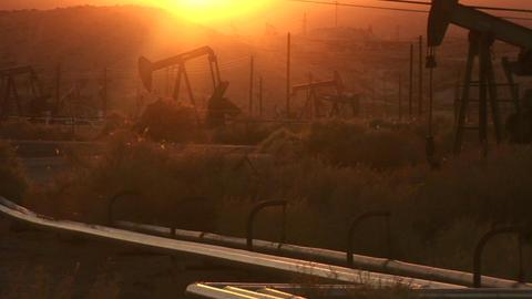 Oil derricks pump at sunset Stock Video Footage