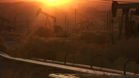 Oil derricks pump at sunset Stock Video Footage