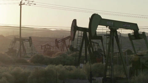 Time lapse of oil derricks pumping Stock Video Footage