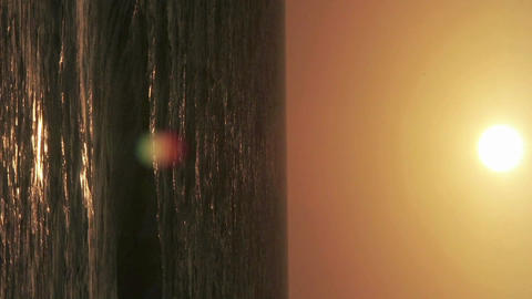 A time lapse vertical angle of the sun setting over the ocean Footage