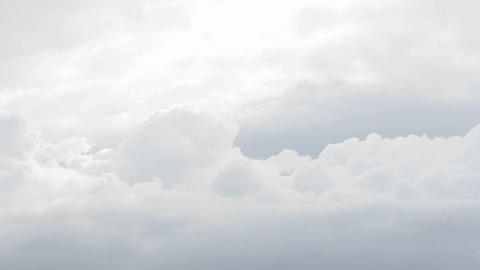 Time lapse of white and grey clouds moving quickly Stock Video Footage