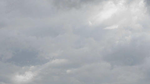 Time lapse of white and grey clouds moving quickly Footage