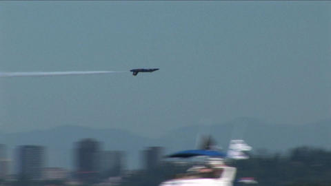 A Blue Angels jet barrel rolls and flies past other... Stock Video Footage