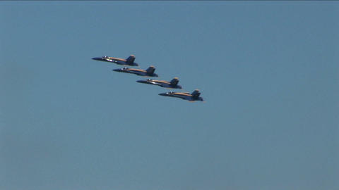 Four Blue Angels jets fly in formation Stock Video Footage