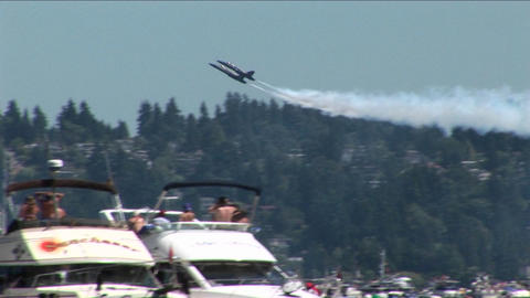 Blue Angels jets fly over crowds of people and boats Footage