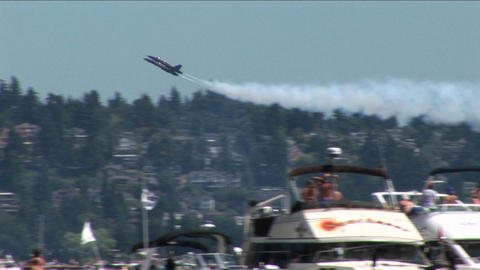Blue Angels jets fly over crowds of people and boats Stock Video Footage