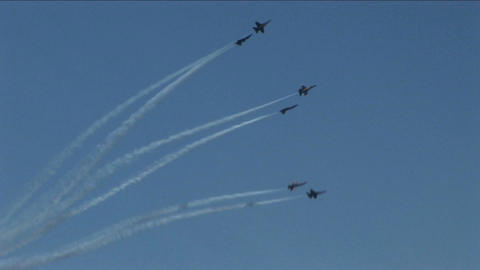 Six Blue Angels jets fly in formation and break into groups of twos Footage