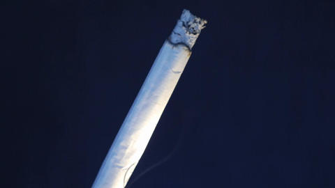 A time lapse of a cigarette burning into ash Stock Video Footage