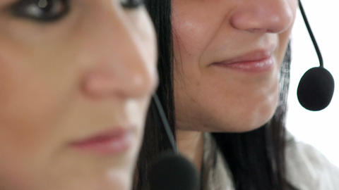 women at work in the call center: customer center operators, headsets Live Action