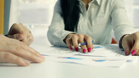 businesspeople at work on budget analysis: financial charts, businesswomen Footage