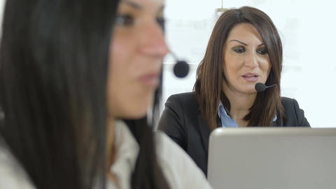call center: women at work with computer and headset Footage