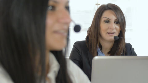 customer care center: women at work with computer and headset Footage