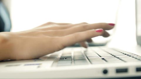 woman's hands typing on the keyboard of a laptop Footage