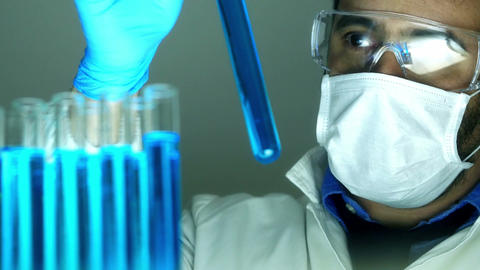 scientist working in a laboratory with test tubes and pipettes Footage