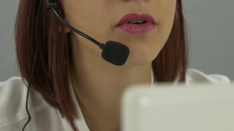 call center operator with headset and computer Footage