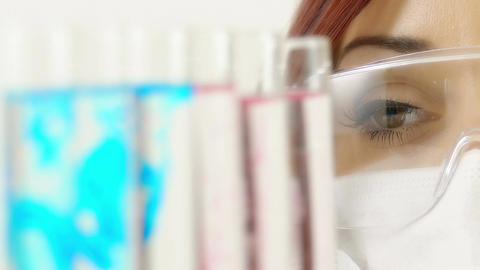 closeup portrait of young female researcher at work in a laboratory Footage