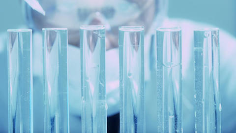 scientific research: chemical laboratory: scientist at work with test tubes Footage