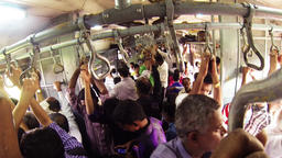People travel on a busy commuter train in Mumbai Footage