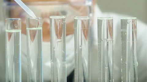 Lab technician performs medical tests Footage