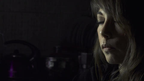 Woman smokes in the dark Footage