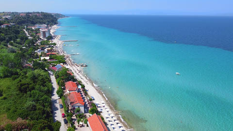 Aerial view of touristic resort with hotels, bars and sand beach on turquoise clear sea on exotic Live Action
