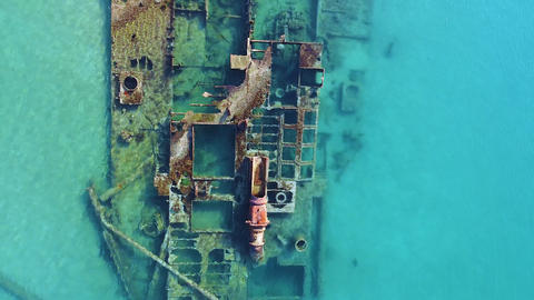 Bird view of shipwreck lying in turquoise crystal clear sea. Aerial view Live Action