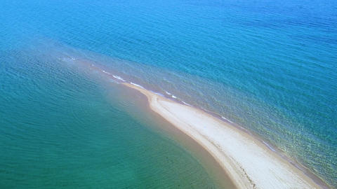 Aerial view of Epanomi beach near Thessaloniki in Greece. Exotic sandbank beach with tranquil clear Live Action