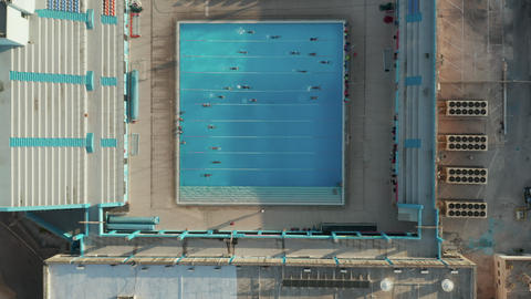 Epic view of training Swimmers doing lanes in Blue Pool in Sunshine Live Action