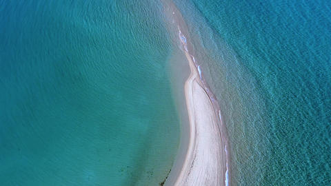 Epanomi sandbank beach and amazing turquoise clear Aegean sea. Aerial view Live Action