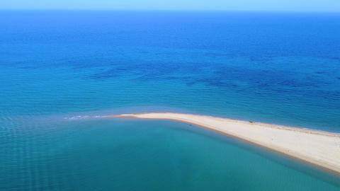 Exotic touristic destination, tropic sandbank beach and turquoise clear sea. Aerial view Live Action