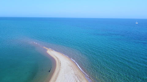 Long sand tropic beach and tranquil turquoise clear Aegean sea. Aerial view Live Action