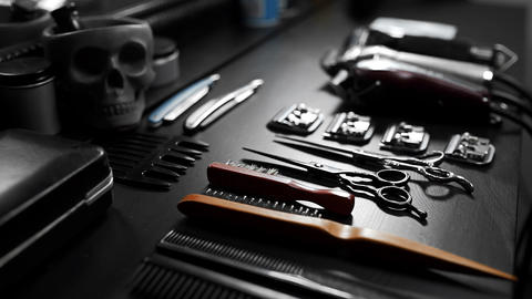 Stylish equipment table with scissors and trimmers and dark scull at the barber shop 2 Live Action