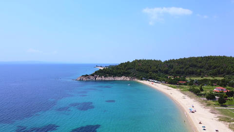 Sand beach and beautiful tropic sea. Aerial drone view of vacation resort and sea Live Action