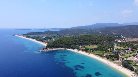 Seacoast with trees, vacation resort and sand beaches on blue clean tranquil sea. Aerial view Live Action