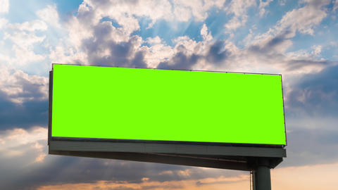Timelapse - blank green billboard and sun beams shining through clouds at sunset Live Action