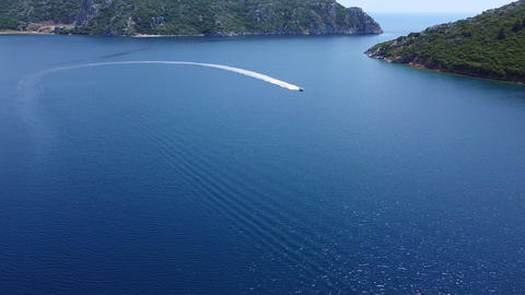 Speed boat sailing in bay in summer. Adventure vacation concept. Aerial view Live Action