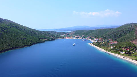 Bay with blue sea water and touristic vacation resort with hotels and sand beaches and yacht in the Live Action