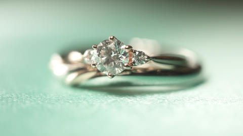 Pair of rings in a cup, wedding ring, diamond ring, macro photography Live Action
