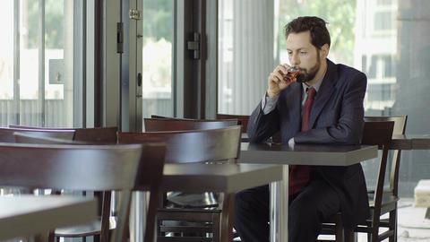 depressed elegant man drinking alcohol Footage