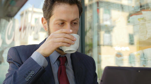 businessman working with with laptop and drinking coffee Footage