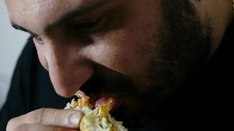 man eating a hamburger: junk food, diet, obesity, healthcare Live Action